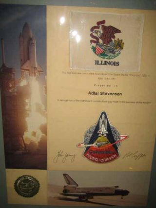 "This flag and crew patch were flown aboard the Space Shuttle ""Columbia"" (STS-1) / April 12-14,..."